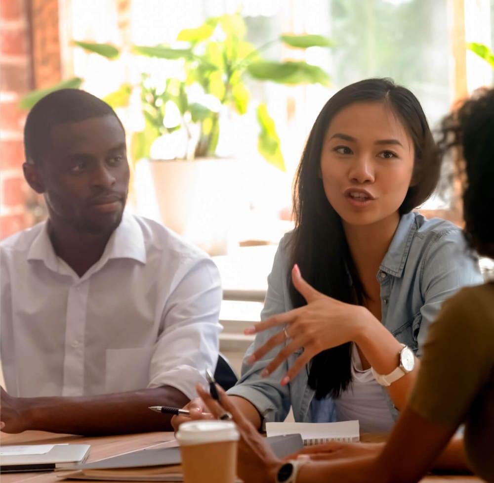 HR Team brainstorming human capital management process.